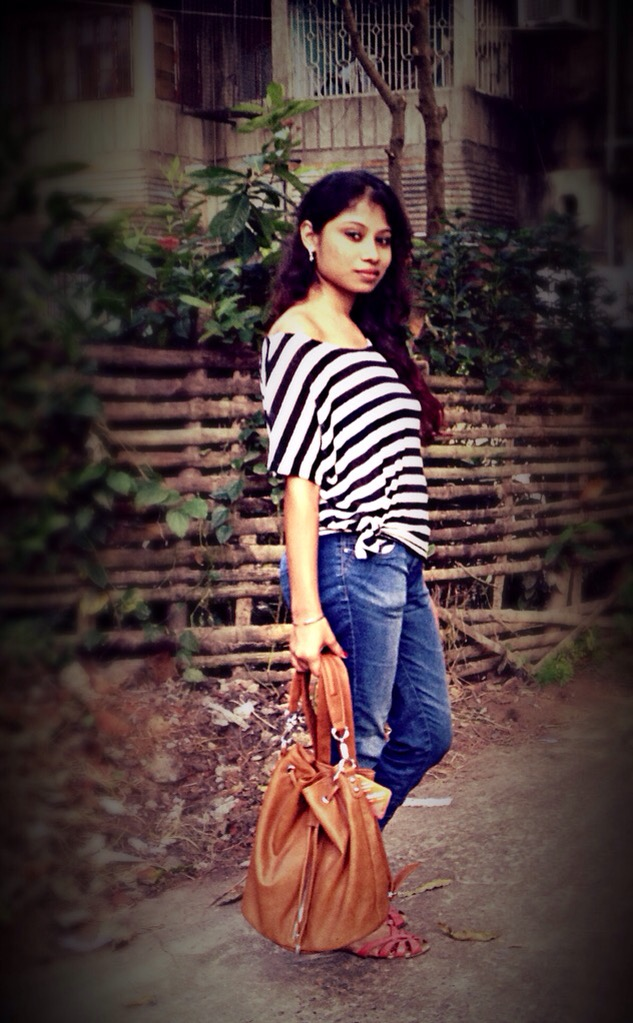 Street style in denims and offshoulder top