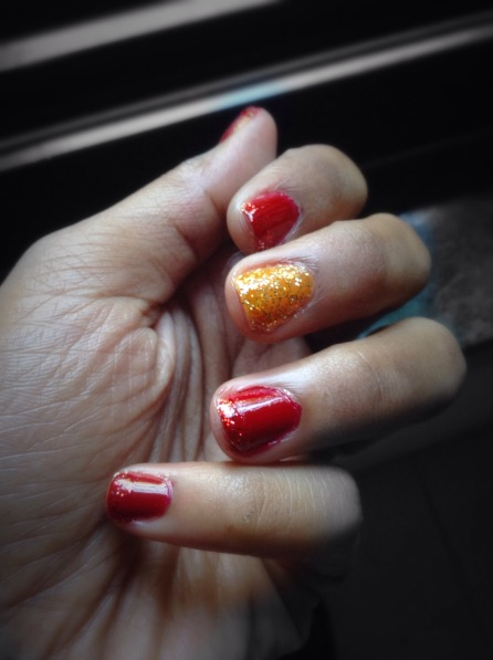 red and gold glitter nail paint