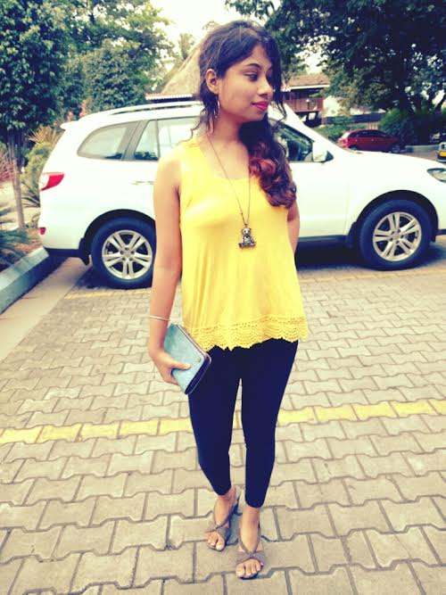 Styling the yellow top with black leggings
