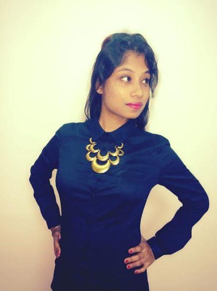 Black shirt with statement neckpiece